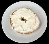 picture of bagel  - Bagel with cream cheese on a plate on a black background - JPG
