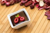 Chocolate Dark Pudding With Raspberries And Mint Leaf