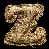 Linen or hemp vintage cloth letter Z isolated on black background