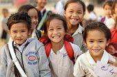 SAYABURI, LAOS, FEBRUARY 16, 2012 :Happy Loatian little girls posing in the schoolyard during the Elephant festival in Sayaburi, Laos