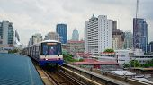 BTS Skytrain on elevated rails above Sukhumvit Road in Bangkok.