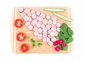 Radish cucumber and tomato on platter.