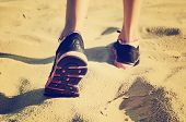 Tinted Vanilla Effect Image Girls Feet In Sneakers Go Away On The Sand