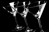 Empty martini glasses on a black background in horizontal format