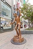 Sculpture Of A Man Lets Shake Hands In Busan, Korea
