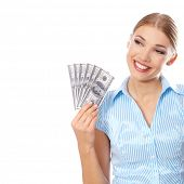 Young pretty blond woman smiling while holding six American hundred-dollar bills  concept of profit