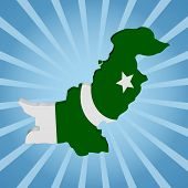 stock photo of pakistani flag  - Pakistan map flag on blue sunburst illustration - JPG