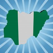 Nigeria map flag on blue sunburst illustration