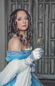 Beautiful Medieval Woman In Blue Dress With Mirror