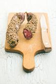 dried sausage with peppercorn on cutting board