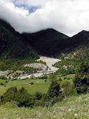 Glacier River In A Himalayan Meadow