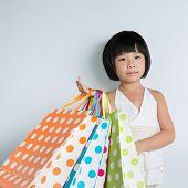 Little Asian Girl Holding Shopping Bags