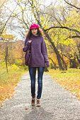 Young Beautiful Woman Walking Along Autumn City Park