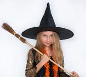 Girl posing in witch dress, Halloween little witch