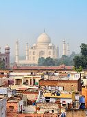 Poor Neighborhoods And Luxurious Taj Mahal. Agra, India