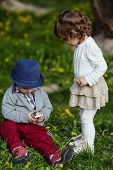 boy and girl playing with mobile phone