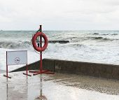 Warning sign and a life buoy