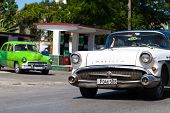 HAVANA,CUBA - June 27, 2014: White and green classic car on the road in havana