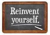 reinvent yourself - advice or motivational reminder  on a vintage slate blackboard