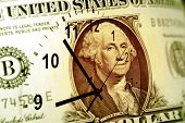 Clock and American banknote. Time is money concept