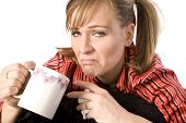 picture of feeling better  - A woman drinking her drink to help her feel better with a solom expression on her face - JPG