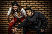 Two young modern dancers posing together. Urban lifestyle. Hip-hop generation.