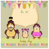 Happy family of owls