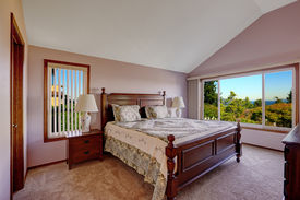 foto of master bedroom  - Master bedroom interior in light pink color with scenic windown view - JPG