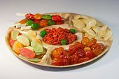 A mixture of candied dried fruits on a plate