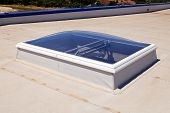 stock photo of hydro  - Flat roof with skylight and hydro insulation membranes - JPG
