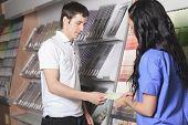 A sales assistant portrait in home appliance shop supermarket st