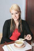 A social girl in a sushi restaurant