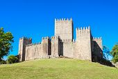 picture of castle  - The Castle of Guimaraes is the principal medieval castle in the municipality Guimaraes Portugal - JPG