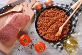Bolognese Sauce In A Pan And Ingredients Horizontal Top View