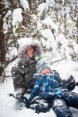 Mother And Child Playing Outdoor In Winter