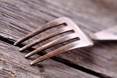 Metal Fork On A Simple Wooden Table As A Concept Of Rural Lifestyle