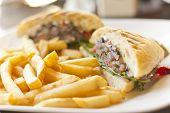 image of sandwich  - Portobello mushroom sandwich on a toasted ciabatta bun and side of fries  - JPG