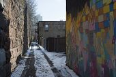 Narrow winter street, drawing on the wall
