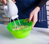 picture of cake-mixer  - Mixing white egg cream in bowl with motor mixer - JPG
