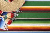 pic of mexican  - Mexican background with sombrero straw hat maracas and traditional serape blanket or rug - JPG