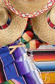 stock photo of maracas  - Mexican scene with sombrero straw hat maracas and traditional serape blanket or rug - JPG