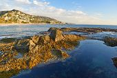 picture of tide  - Tide pools sit on the beach in Laguna Beach - JPG