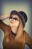 picture of tramp  - Tramp girl wears old top hat in vintage photo style - JPG