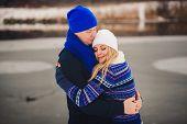 Sweet Couple Hugging In Winter Park