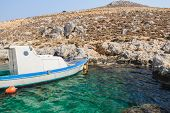 Fishing motorboat near rocky island Kalymnos