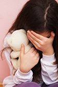 stock photo of cry  - Sad and Lonely Girl Crying with a Hand Covering her Face - JPG