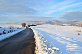 road snow covered landscape