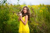 image of green snake  - Beautiful young girl with snake in a park - JPG