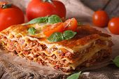 Italian Lasagna Close-up On The Table. Horizontal Rustic