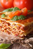 Tasty Lasagna With Basil And Tomatoes On An Old Table, Vertical